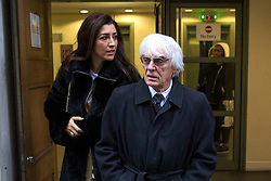 © Licensed to London News Pictures. 11/01/2018. London, UK. Bernie Ecclestone leaves the High Court with his wife Fabiana Flosi during a hearing over his daughter Petra Ecclestone's legal battle with ex-husband James Stunt following their £5.5billion divorce. Photo credit: Rob Pinney/LNP