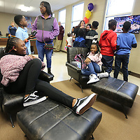 Sanyia Hamilton, 10, and Samya Ford, 10, relax Friday afternoon on new furniture that was donated to the Northside Boys and Girls Club location. Six gaming consoles along with TV's and stands were also donated. The same donations were also made to the Haven Acres location.