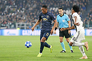 Manchester United Forward Anthony Martial battles with Juventus Forward Juan Cuadrado during the Champions League Group H match between Juventus FC and Manchester United at the Allianz Stadium, Turin, Italy on 7 November 2018.