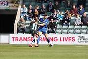 Plymouth Argyle defender Jamille Matt  (19) and Jon Meades midfielder for AFC Wimbledon (12) tussle during the Sky Bet League 2 match between Plymouth Argyle and AFC Wimbledon at Home Park, Plymouth, England on 9 April 2016. Photo by Stuart Butcher.