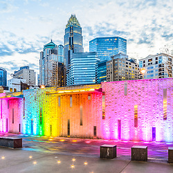 Charlotte NC skyline panorama photo with Romare Bearden Park at dusk. Charlotte, North Carolina is a major city in the Eastern United States of America. Panorama photo ratio is 1:3.