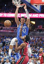 October 17, 2018 - Orlando, FL, USA - The Orlando Magic's Aaron Gordon (00) dunks over the Miami Heat's Derrick Jones Jr. in the first half at the Amway Center in Orlando, Fla., on Wednesday, Oct. 17, 2018. (Credit Image: © Stephen M. Dowell/Orlando Sentinel/TNS via ZUMA Wire)