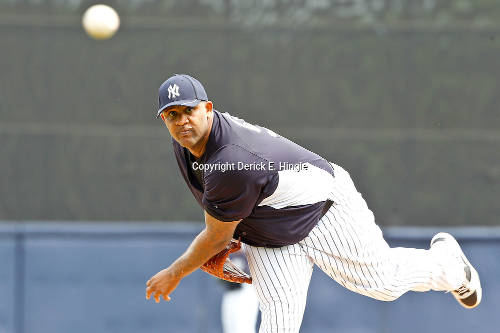 March 11, 2012; Tampa Bay, FL, USA; New York Yankees starting pitcher CC Sabathia (52) warms up before the start of a spring training game against the Philadelphia Phillies at George M. Steinbrenner Field. Mandatory Credit: Derick E. Hingle-US PRESSWIRE