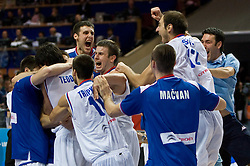 Players of Serbia celebrate after the EuroBasket 2009 Semi-final match between Slovenia and Serbia, on September 19, 2009, in Arena Spodek, Katowice, Poland. Serbia won after overtime 96:92.  (Photo by Vid Ponikvar / Sportida)
