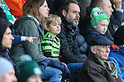 Young FGR fan watches on during the EFL Sky Bet League 2 match between Forest Green Rovers and Swindon Town at the New Lawn, Forest Green, United Kingdom on 21 December 2019.