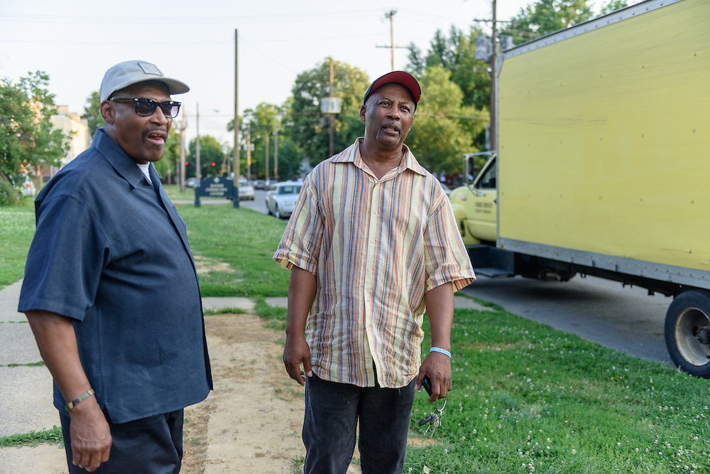 Eddie Woods, director of Street Peace: No More Red Dots, left, and Norman Martin, Street Peace's team coordinator, look up 12th Street Monday, June 20, 2016 along Baxter Park in the Beecher Terrace neighborhood. (Photo by Brian Bohannon)