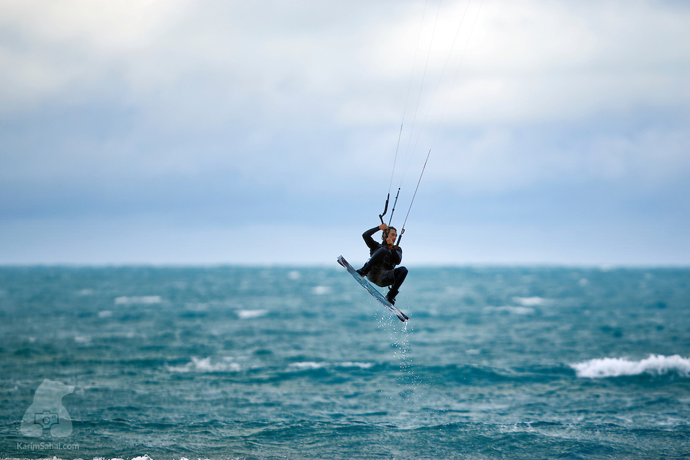 A kiteboarder suspended in the air at Lyall Bay, Wellington, New Zealand.