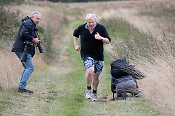 © Licensed to London News Pictures. 02/10/2018. Thame, UK. Boris Johnson runs past photographers as he jogs near his Oxfordshire home. The former foreign secretary is due to speak at a fringe event at the Conservative Party Conference later . Photo credit: Peter Macdiarmid/LNP