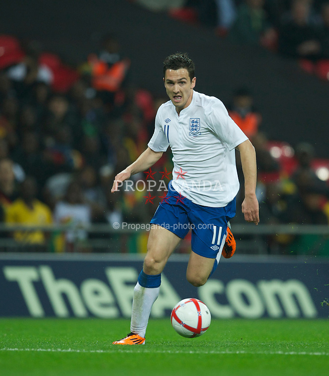 LONDON, ENGLAND - Tuesday, March 29, 2011: England's Stewart Downing in action against Ghana during the international friendly match at Wembley Stadium. (Photo by David Rawcliffe/Propaganda)