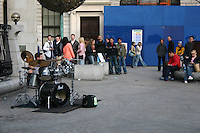 Drummer busking at the Central Bank Temple Bar Dublin Ireland<br />