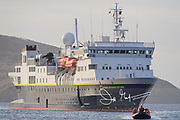 A zodiac transports expedition travelers from the National Geographic Explorer to New Island, Falkland Islands.