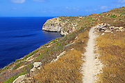Coastal clifftop footpath near Ta' Cenc, island of Gozo, Malta