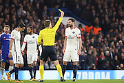 Paris Saint Germain midfielder Thiago Motta (8) yellow card during the Champions League match between Chelsea and Paris Saint-Germain at Stamford Bridge, London, England on 9 March 2016. Photo by Matthew Redman.