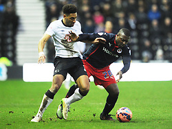 Derby Ryan Shotton battles with Yakubu, Derby County v Reading, FA Cup 5th Round, The Ipro Stadium, Saturday 14th Febuary 2015