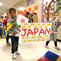 Adam Robison | BUY AT PHOTOS.DJOURNAL.COM<br /> London Bumpus and Elizabeth Pannel, ECEC Pre-K students, hold their banner for Japan, the country they studied in class, as they walk in the parade of countires Friday morning at ECEC in Tupelo.