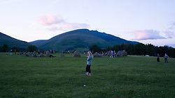 © Licensed to London News Pictures. <br /> 20/06/2014. <br /> <br /> Castlerigg Stone circle, Cumbria, England<br /> <br /> Visitors to the ancient site of Castlerigg Stone Circle near Keswick in Cumbria come together to celebrate on the evening of the Summer Solstice.<br /> <br /> Photo credit : Ian Forsyth/LNP