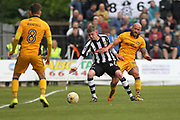 David Pipe challenged by Alex Howes during the EFL Sky Bet League 2 match between Newport County and Notts County at Rodney Parade, Newport, Wales on 6 May 2017. Photo by Daniel Youngs.