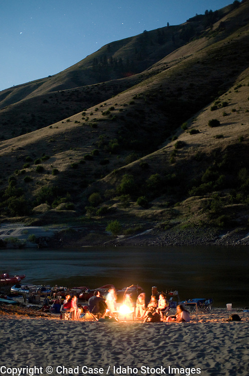 Idaho. Lower Salmon River. Idaho. Lower Salmon River. Playing guitar around campfire. MR