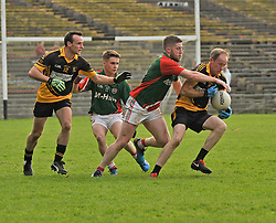 Lahardane's Gary Naughton tries to hold off Kilmaine's Frank Burke during the County junior final. <br /> Pic Conor McKeown