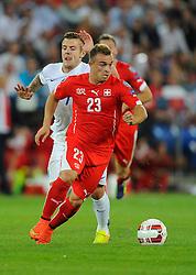 England's Jack Wilshere (Arsenal) battles for the ball with Switzerland's Xherdan Shaqiri - Photo mandatory by-line: Joe Meredith/JMP - Mobile: 07966 386802 - 08/09/14 - SPORT - FOOTBALL - Switzerland - Basel - St Jacob Park - Switzerland v England - Uefa Euro 2016 Group E Qualifier