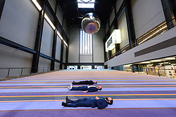 &copy; Licensed to London News Pictures. 02/10/2017. London, UK. RASMUS NIELSEN, JAKOB FENGER and BJORNSTJERNE CHRISTIANSEN of <br /> Copenhagen artist group SUPERFLEX transforms the Tate Modern Turbine Hall with their creation  'One Two Three Swing!' for the third Hyundai Commission. Based in Copenhagen SUPERFLEX was founded in 1993 by Danish artists and Bj&oslash;rnstjerne Christiansen, Jakob Fenger and Rasmus Nielsen. They have gained international recognition for their projects and solo exhibitions around the world. Photo credit: Ray Tang/LNP