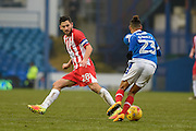 Accrington Stanley Midfielder, Seamus Conneely (28) and Portsmouth Midfielder, Kyle Bennett (23) during the EFL Sky Bet League 2 match between Portsmouth and Accrington Stanley at Fratton Park, Portsmouth, England on 11 February 2017. Photo by Adam Rivers.