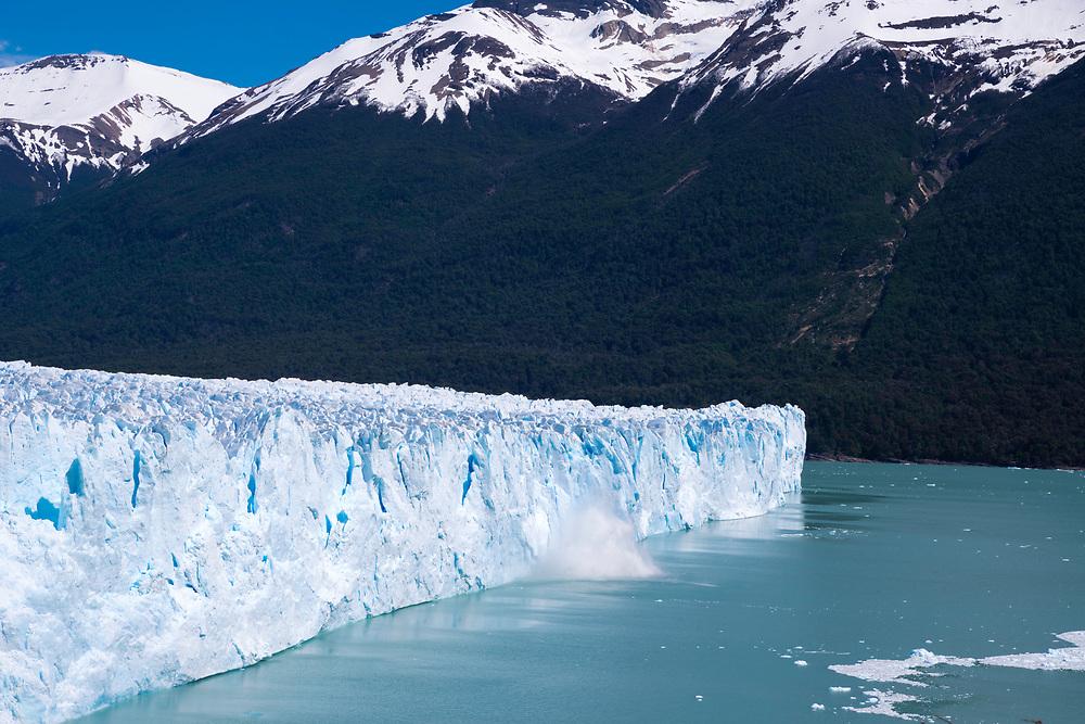View of the Perito Moreno Glacier as it calves, Los Glaciares National Park, near El Calafate, Santa Cruz Province, Argentina.