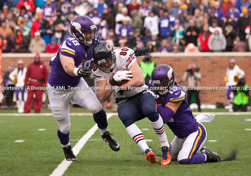 Dec 28, 2014: Minnesota Vikings Fullback Zach Line (48) [18684] and Minnesota Vikings Wide Receiver Adam Thielen (19) [14328] tackle Chicago Bears Wide Receiver Marc Mariani (80) [10506] during the first half. The Vikings beat the Bears 13-9at TCF Bank Stadium in Minneapolis, MN.