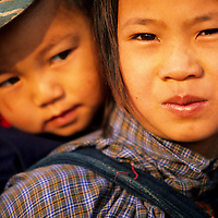 Young Girl holds little brother, Muang Singh, Laos