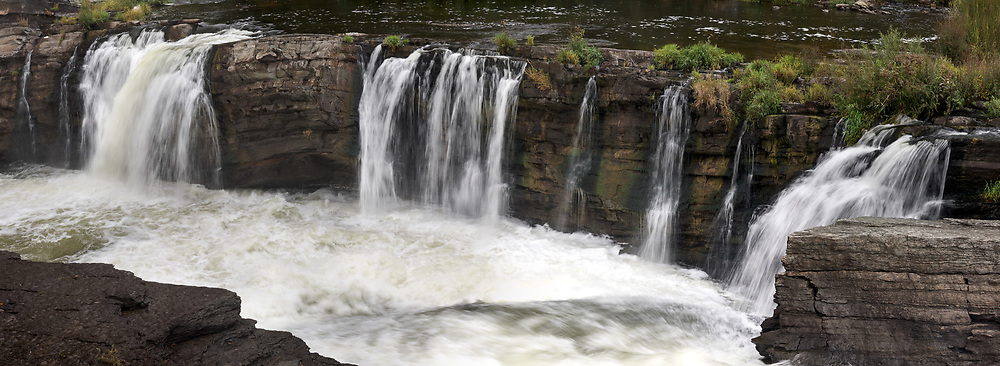Side view of the Rideau River flowing over Hog's Back Falls in Ottawa, Ontario, Canada.  Photographed from Hog's Back Park.