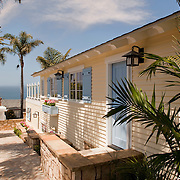 Cardiff By The Sea is a small Southern California beach town on a hill overlooking the Pacific. Virtually every house on every street has some sort of ocean view. Architect Sam Chereskin and Kelley Cozzolino of Bigelow Interiors designed this thoughtful variation on the beach house theme in 2010 - a classic clapboard cottage.
