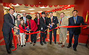 Ribbon cutting during the dedication for the Mandarin Immersion Magnet School, October 24, 2016.