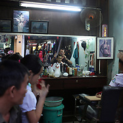 A Vietnamese boy receives a hair cut at a barbers shop in Hoi An, Vietnam. Hoi An is an ancient town and an exceptionally well-preserved example of a South-East Asian trading port dating from the 15th century. Hoi An is now a major tourist attraction because of its history. Hoi An, Vietnam. 5th March 2012. Photo Tim Clayton