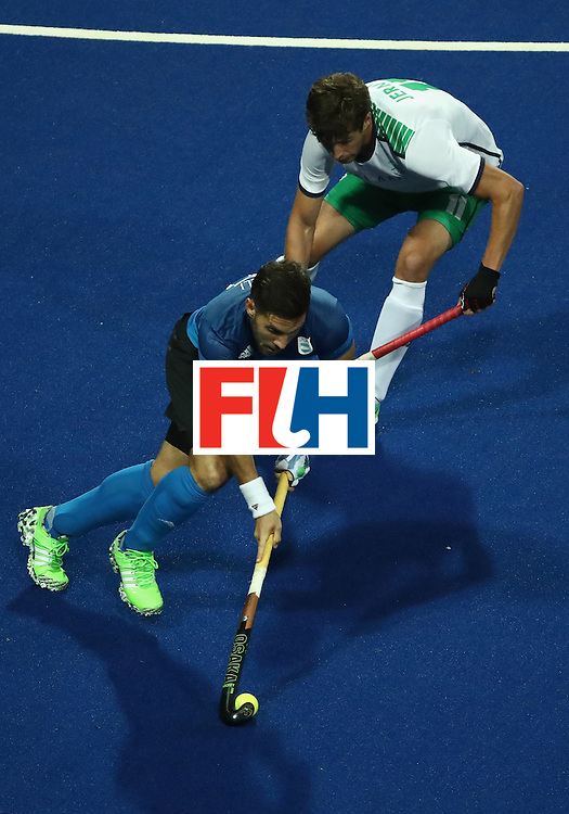RIO DE JANEIRO, BRAZIL - AUGUST 12:  Agustin Mazzilli #26 of Argentina eludes John Jermyn #11 of Ireland during a Men's Preliminary Pool A match on Day 7 of the Rio 2016 Olympic Games at the Olympic Hockey Centre on August 12, 2016 in Rio de Janeiro, Brazil.  (Photo by Sean M. Haffey/Getty Images)