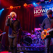 Martin Blunt, Tim Burgess and Mark Collins of The Charlatans performs at the Howard Theatre in Washington, D.C.