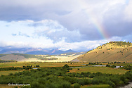 The Big Hole River with rainbow and Pintler Mountains in background in Montana