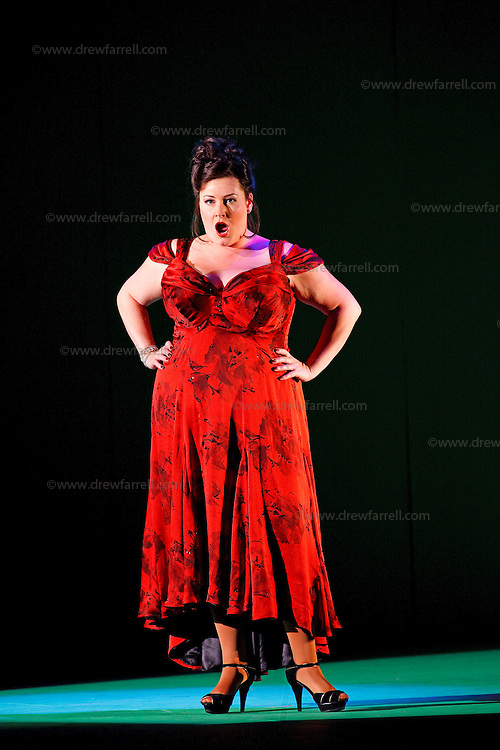 Picture shows : Karen Cargill as Isabella..Picture  ©  Drew Farrell Tel : 07721 -735041..A new Scottish Opera production of  Rossini's 'The Italian Girl in Algiers' opens at The Theatre Royal Glasgow on Wednesday 21st October 2009..(Soap) opera as you've never seen it before.Tonight on Algiers.....Colin McColl's cheeky take on Rossini's comic opera is a riot of bunny girls, beach balls, and small screen heroes with big screen egos. Set in a TV studio during the filming of popular Latino soap, Algiers, the show pits Rossini's typically playful and lyrical music against the shoreline shenanigans of cast and crew. You'd think the scandal would be confined to the outrageous storylines, but there's as much action off set as there is on.... .Italian bass Tiziano Bracci makes his UK debut in the role of Mustafa. Scottish mezzo-soprano Karen Cargill, who the Guardian called a 'bright star' for her performance as Rosina in Scottish Opera's 2007 production of The Barber of Seville, sings Isabella. .Cast .Mustafa...Tiziano Bracci.Isabella..Karen Cargill.Lindoro...Thomas Walker.Elvira...Mary O'Sullivan.Zulma...Julia Riley.Haly...Paul Carey Jones.Taddeo...Adrian Powter. .Conductors.Wyn Davies.Derek Clarke (Nov 14). .Director by Colin McColl.Set and Lighting Designer by Tony Rabbit.Costume Designer by Nic Smillie..New co-production with New Zealand Opera.Production supported by.The Scottish Opera Syndicate.Sung in Italian with English supertitles..Performances.Theatre Royal, Glasgow - October 21, 25,29,31..Eden Court, Inverness - November 7. .His Majesty's Theatre, Aberdeen  - November 14..Festival Theatre,Edinburgh - November 21, 25, 27 ...Note to Editors:  This image is free to be used editorially in the promotion of Scottish Opera. Without prejudice ALL other licences without prior consent will be deemed a breach of copyright under the 1988. Copyright Design and Patents Act  and will be subject to payment or legal action, where appropriate..Further further information please c