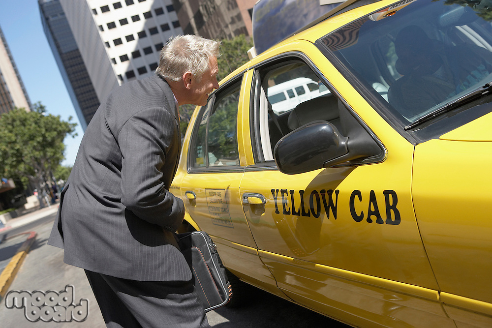 Businessman Talking to Cab Driver