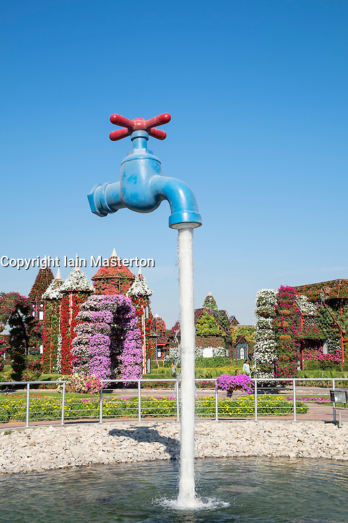 Pond and display at Miracle Garden the world's biggest flower garden in Dubai United Arab Emirates