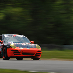 May 23, 2009; Lakeville, CT, USA; The Maxwell Paper Racing Porsche 997 of Daniel DiLeo and Bryan Sellers qualifies for the Grand-Am Koni Sports Car Challenge series competition during the Memorial Day Road Racing Classic weekend at Lime Rock Park.