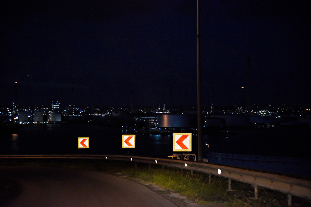 WILLEMSTAD, CURACAO - DECEMBER 12, 2014:  Curacao's Isla Refinery on Willemstad harbor can be seen and smelled from far away. Here's it's seen lit up at night from the top of the Juliana Bridge. (photo by Melissa Lyttle)