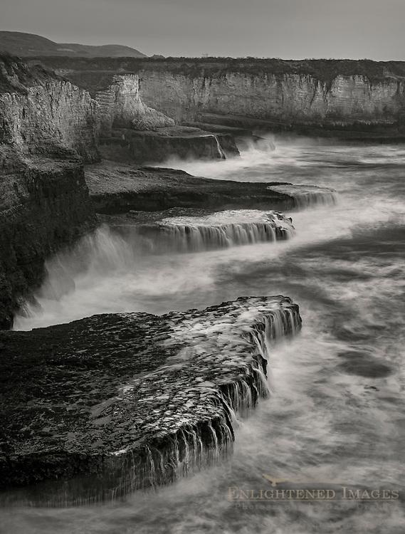 Waves crashing on coastal cliffs at Coast Dairies State Park near Davenport, Santa Cruz County, California