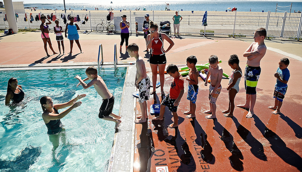 7/26/16 :: REGION :: STAND ALONE :: Children in the beginning level class of the New London Recreation Department's summer swim program get a chance to jump into the pool following their lessons in the pool at Ocean Beach Park Tuesday, July 26, 2016.. (Sean D. Elliot/The Day)