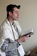 Young Jewish man with tallith and Tefillin