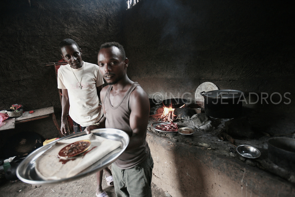 The 'only' restaurant in Salamogo, close to the Bodi tribe.<br /> Here the chef serves the traditional Insjara (sour bread) with a plate of goatmeat.