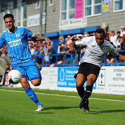 TELFORD COPYRIGHT MIKE SHERIDAN Marcus Dinanga of Telford crosses under pressure from former Buck Simon Grand during the National League North fixture between AFC Telford United and Chester FC at the New Bucks Head on Saturday, September 14, 2019<br /> <br /> Picture credit: Mike Sheridan<br /> <br /> MS201920-018