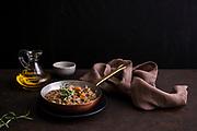 lentil soup in a copper pot on table