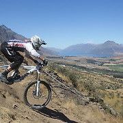 Harriet Latchem in action during the New Zealand South Island Downhill Cup Mountain Bike series held on The Remarkables face with a stunning backdrop of the Wakatipu Basin. 150 riders took part in the two day event. Queenstown, Otago, New Zealand. 9th January 2012. Photo Tim Clayton