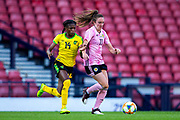Den-Den Blackwood (#14) of Jamaica challenges Lisa Evans (#11) of Scotland for possession of the ball during the International Friendly match between Scotland Women and Jamaica Women at Hampden Park, Glasgow, United Kingdom on 28 May 2019.