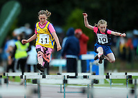 20 Aug 2016: Kate Moore, left, from Roscommon, and Shauna McFadden, from Monaghan, during Girls U10 Hurdles heat.  2016 Community Games National Festival 2016.  Athlone Institute of Technology, Athlone, Co. Westmeath. Picture: Caroline Quinn
